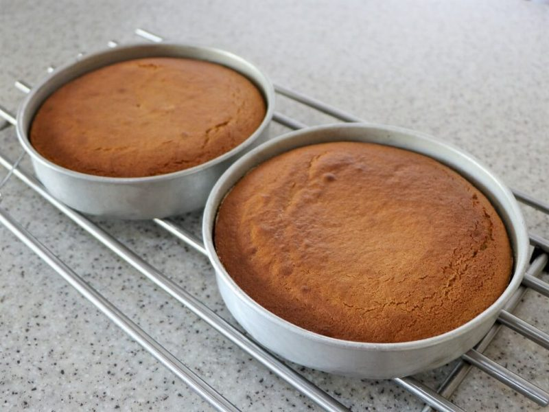 Allow the cakes to cool in their tins.