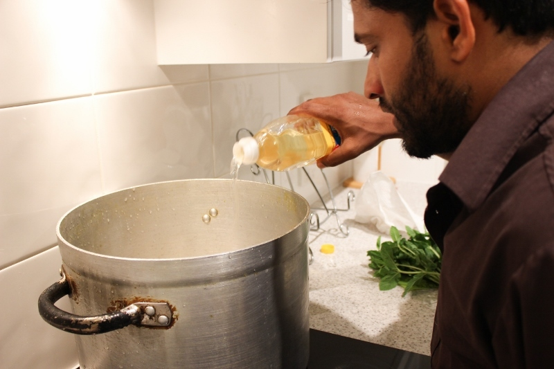 Add coconut oil to the pot.