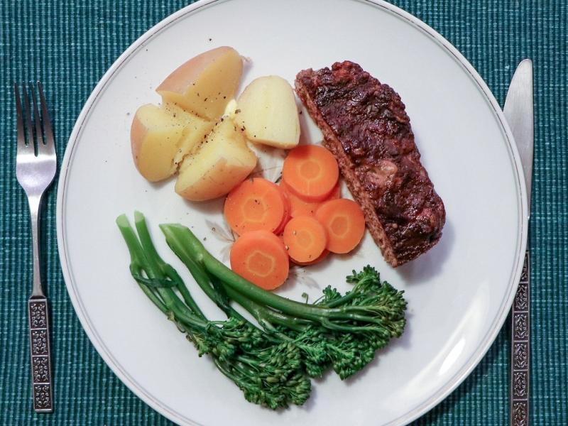 Serve the meatloaf hot with steamed vegetables.