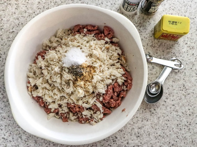 Add crumbs, salt, pepper and mustard to meat mixture.