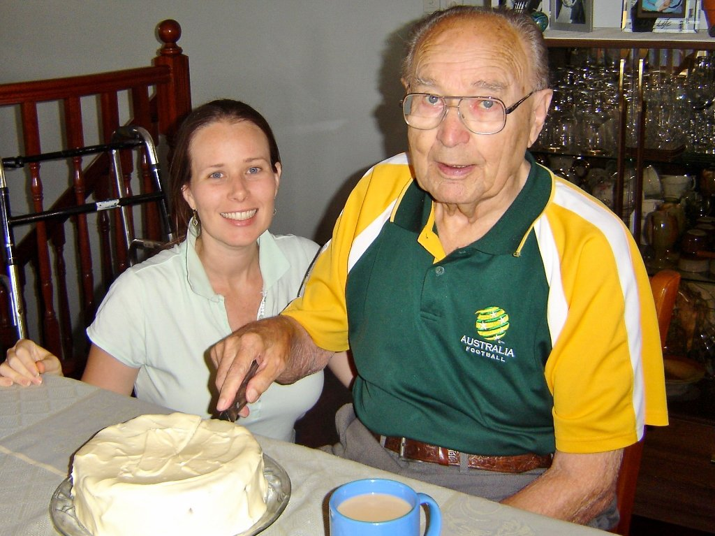 """Ruth with her grandfather (""""Dida"""") cutting his 87th birthday carrot cake. Photo source: Judith Salecich 2006."""
