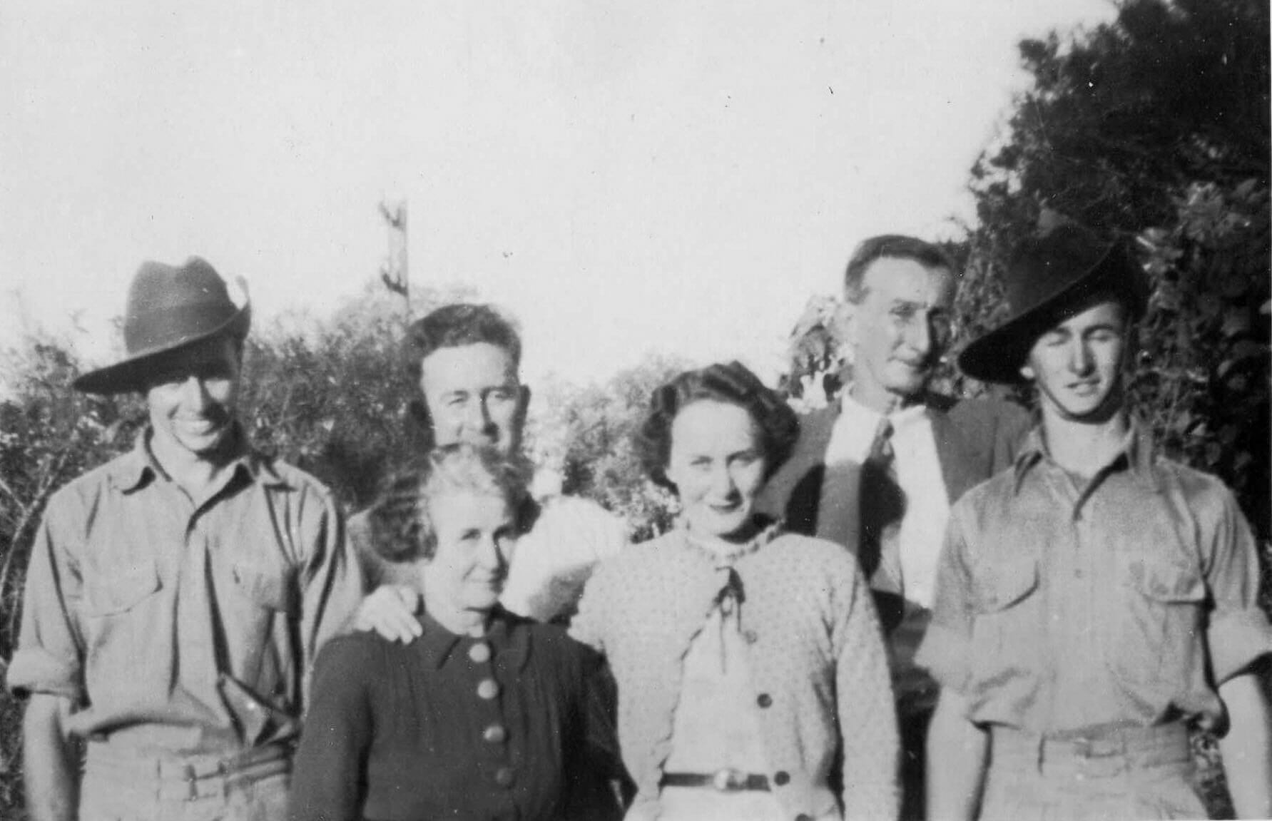 1941: Evelyn with her parents and brothers. Photo source: Beaumont Family archives.