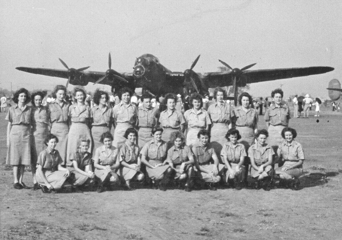 1944: The WAAAFs based at Rockhampton, pictured in front of G for George Lancaster bomber. Photo source: Proposch Family archives.