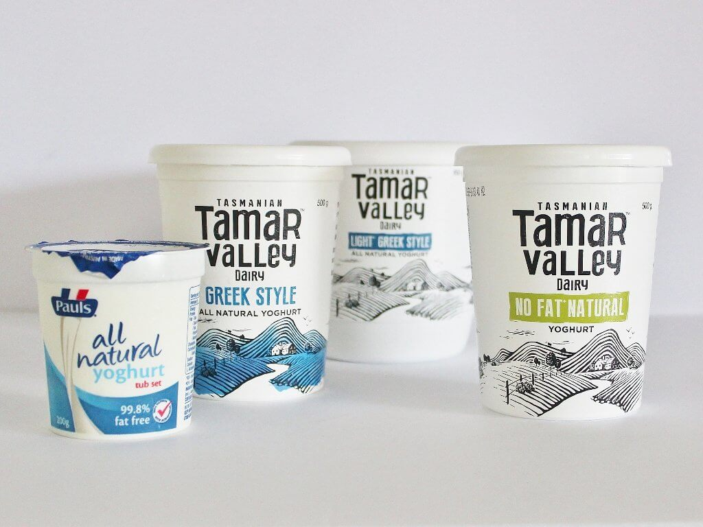 Four different tubs of plain yoghurt. Photo source: Judith Salecich 2016.