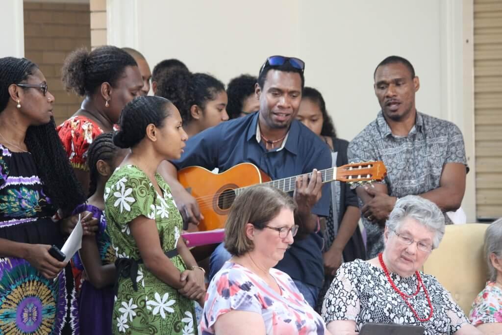 Walo Wayne led the grandchildren in singing. Photo source: Judith Salecich 2016.