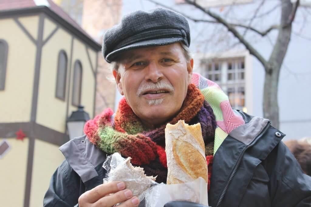 My husband Tony enjoying French bread in Colmar, France. Photo source: Judith Salecich 2015.