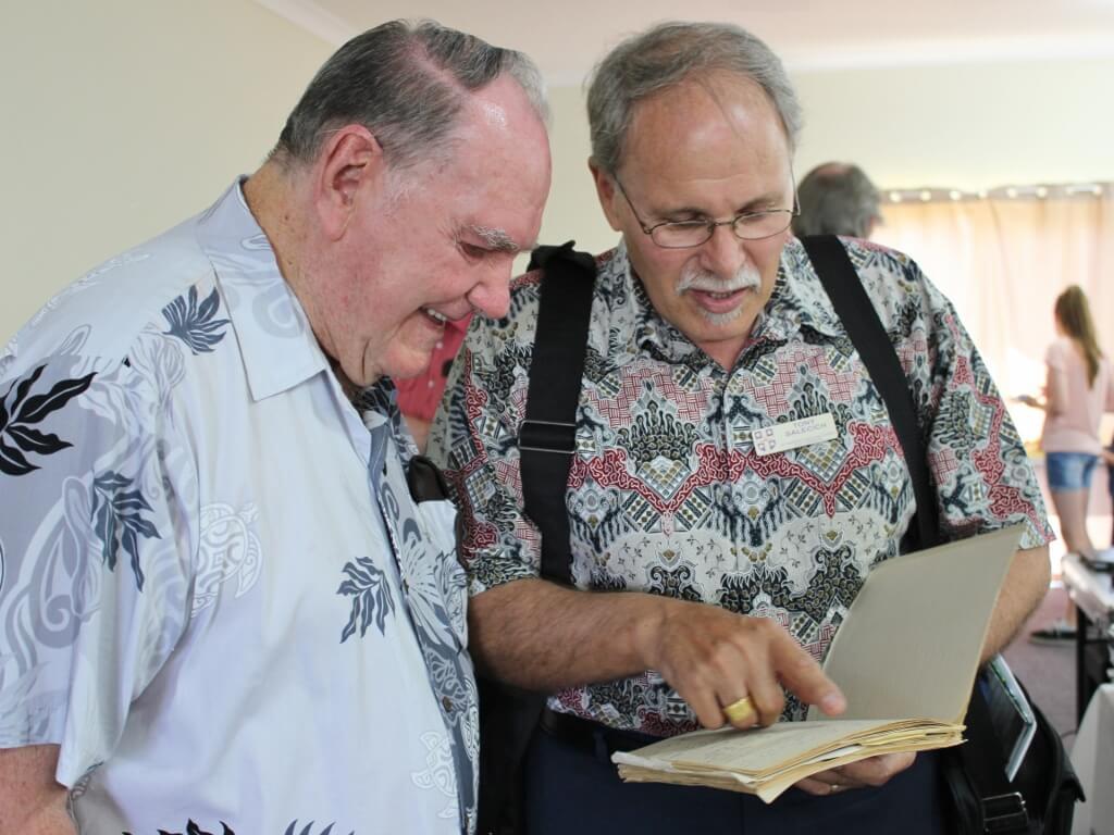 Tony shows Alwyn the 1974 quote. Photo source: Judith Salecich 2016.