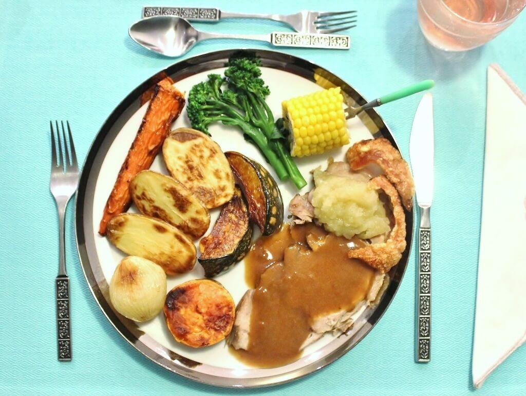 A traditional roast pork meal served. Photo source: Judith Salecich 2017.