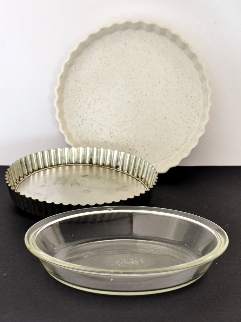 Selection of pie and tart baking pans: A pyrex pie dish, aluminium tart pan with removable bottom and a ceramic tart dish. Photo source: Judith Salecich 2018.