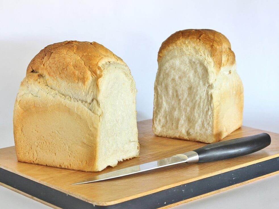 Double loaf of white bread, broken in half. Photo source: Judith Salecich 2018.