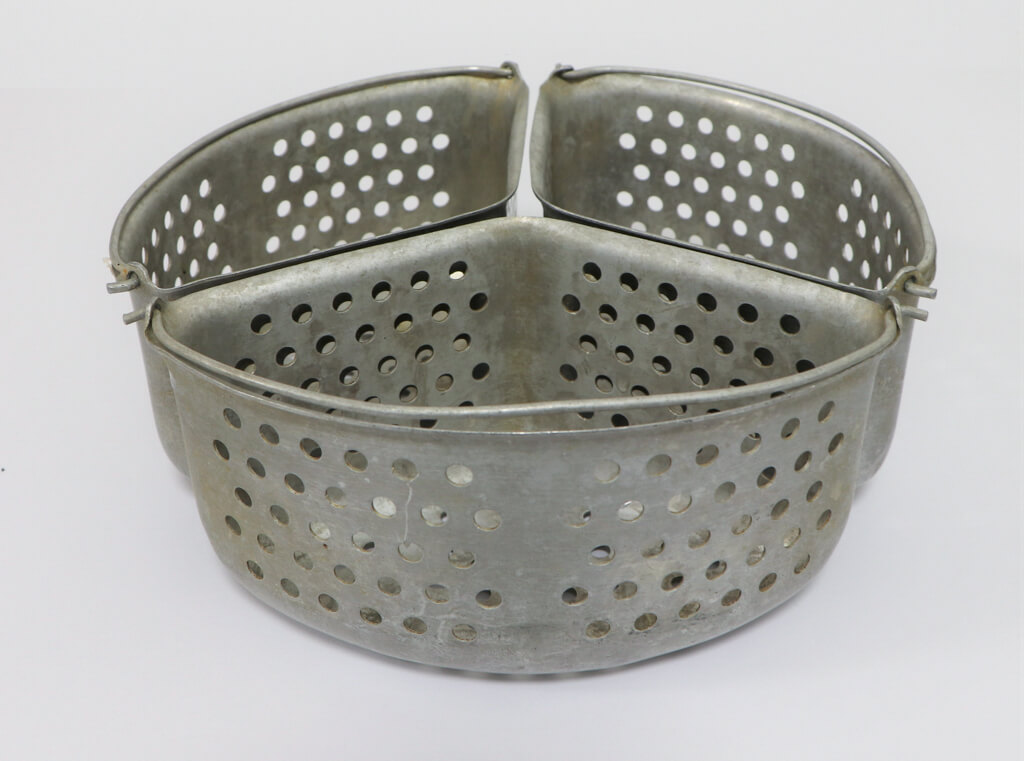 My mother used these triangular aluminium vegetable steamer baskets in her pressure cooker. I now use them in my electric steamer. Photo source: Private collection 2020.
