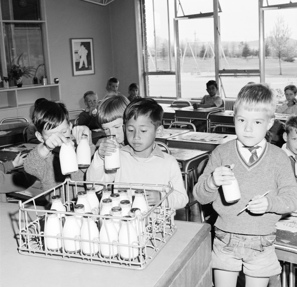 School children taking free milk at a school in the Australian Capital Territory, 1965. Photo source: National Museum of Australia. Used with permission.