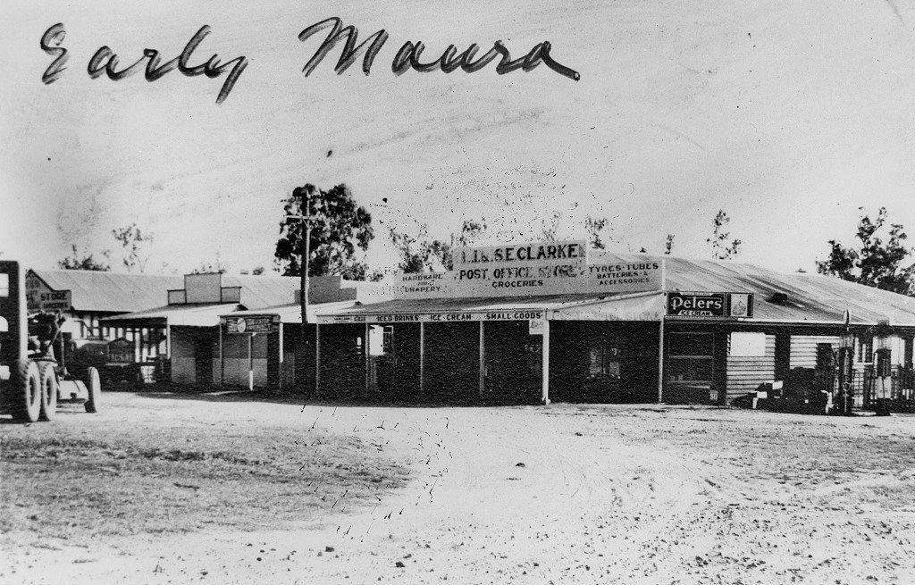 1950s. Early Moura, showing a number of shops in Gillespie Street. The building in my late father's slide collection is just visible behind the grader (or tractor) at left. Photo source: State Library of Queensland. Public domain.