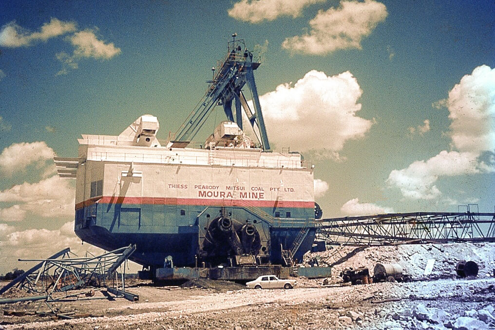 1970s. Dragline, Moura Mine. My father's white Holden sedan is parked nearby. Photo source: My late father's slide collection.