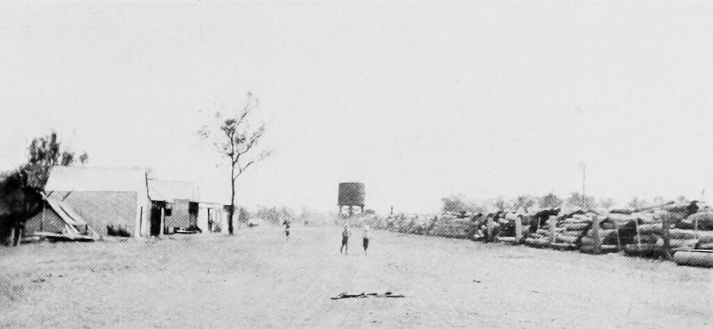 1922. Main street, Rannes, Dawson Valley Line, showing stacks of railway sleepers. Photo source: Nally, P. J. & Queensland Government Intelligence and Tourist Bureau (1923). The Upper Burnett and Callide Valley districts, Queensland: large areas of agricultural, dairying, and grazing land available for selection (1st ed).