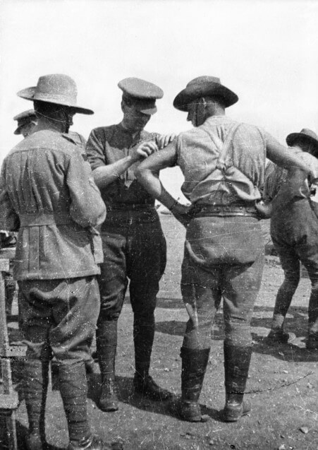 January 1916. An unidentified medical officer inoculates a member of the 2nd Australian Field Artillery Brigade. Inoculation against typhoid was compulsory for all Australian troops before they left Egypt for France. Source: Australian War Memorial. Public domain.