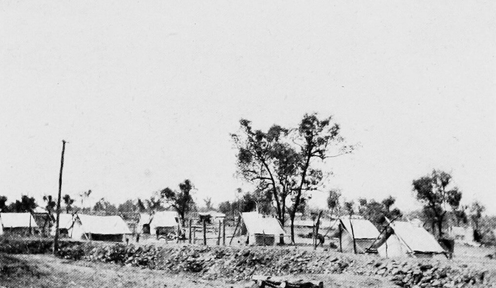 c. 1922. Railway construction camp at Rannes. Photo source: Nally, P. J. & Queensland Government Intelligence and Tourist Bureau (1923). The Upper Burnett and Callide Valley districts, Queensland: large areas of agricultural, dairying, and grazing land available for selection (1st ed).