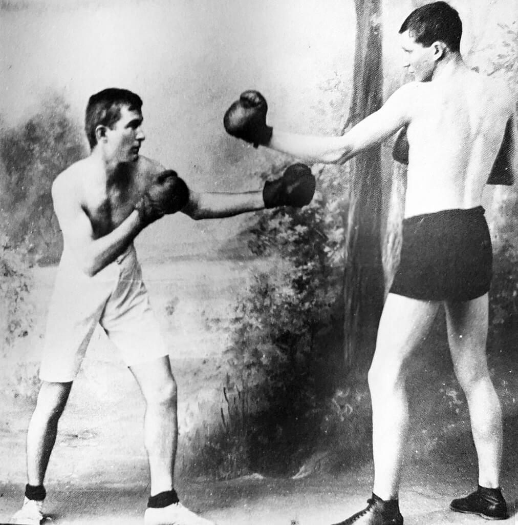 """Bush brother Frederick Hulton-Sams (left) was known as """"The Fighting Parson"""". He was a strong, athletic type and came from a family of boxers and clerics. Photo source: Webb (1978). Public domain."""