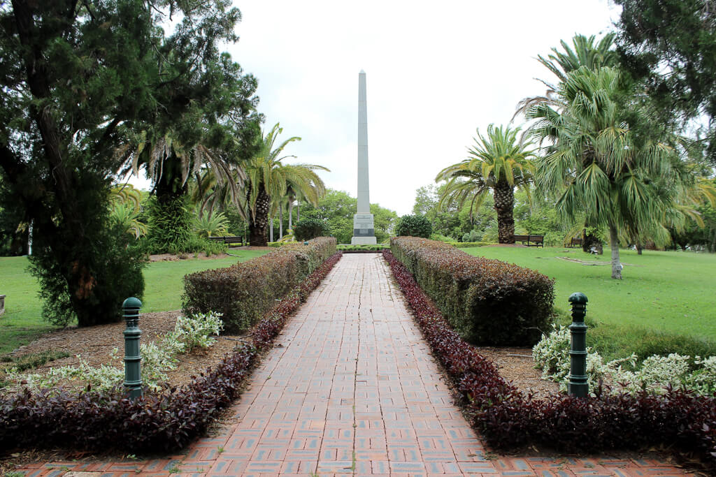 Rockhampton War Memorial. One approaches the memorial by a paved and neatly hedged pathway from the west. Photo source: Salecich Family collection 2018.