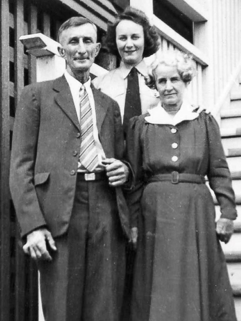 Evelyn with her parents in Brisbane.