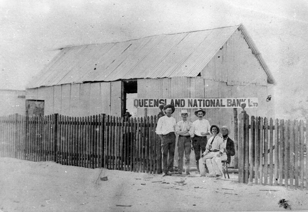 c. 1886. Group of men outside the Queensland National Bank building, Croydon. State Library of Queensland.