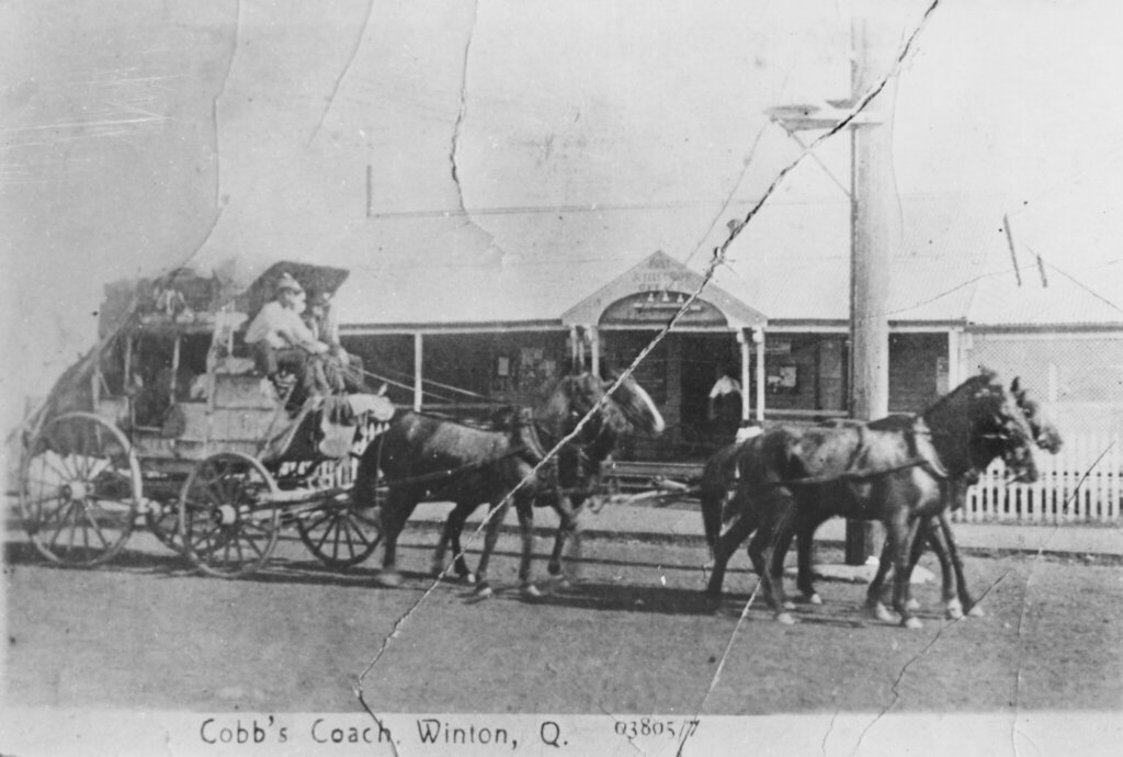 c. 1890-1900. Tom Garner driving a Cobb & Co. coach at Winton, Queensland. Photo source: State Library of Queensland on Flickr. Public domain.
